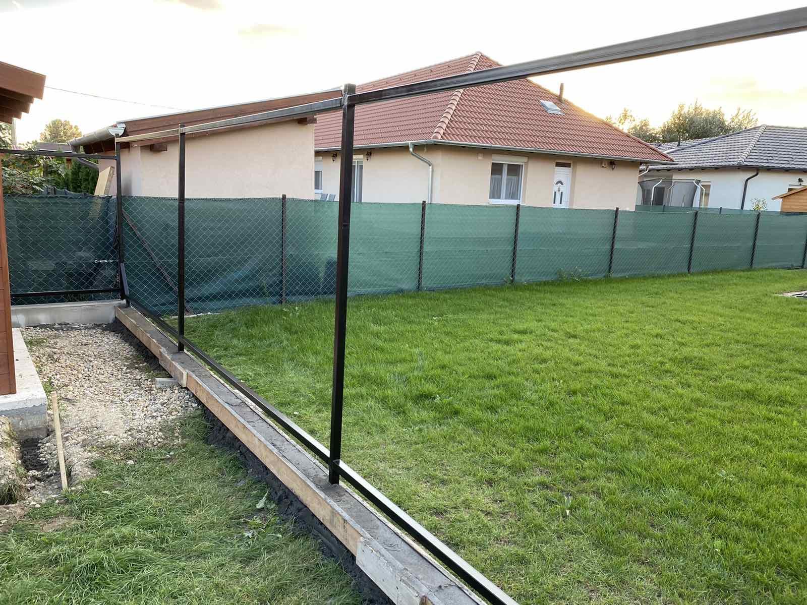 Nagytarcsa kerítés építés zsalukő és trapézlemezből